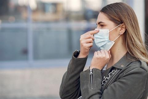 woman-mask-stands-street.jpg